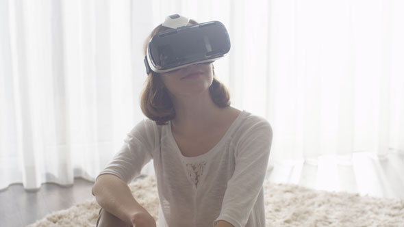 16_74_55_woman_wearing_vr_headset_at_living_room