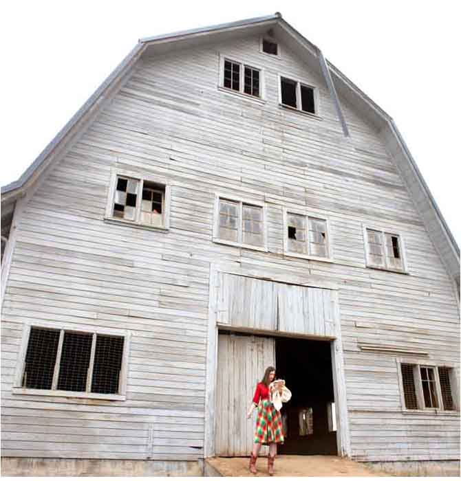 rachel ries with a barn