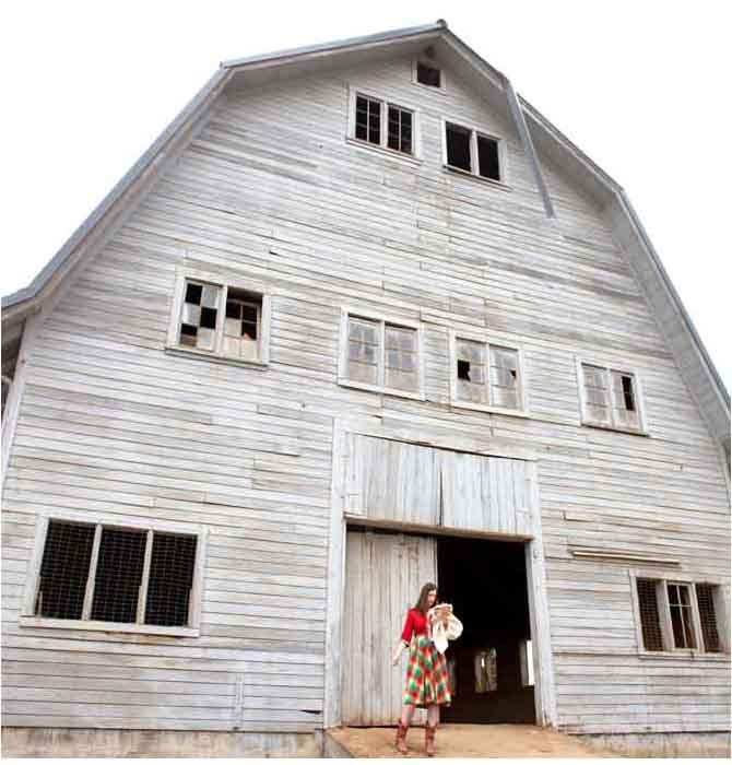 rachel ries with a barn